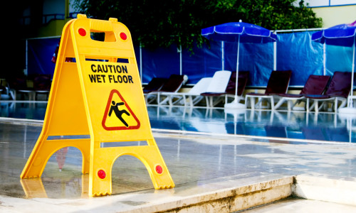 caution wet floor sign by the pool