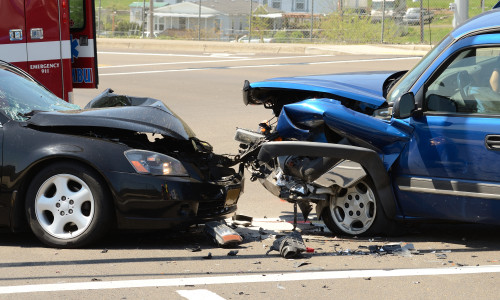 ROSEBURG, OR, USA - APRIL 23, 2012: A two car head on collision results in one person going to the hospital in Roseburg Oregon April 23 2012