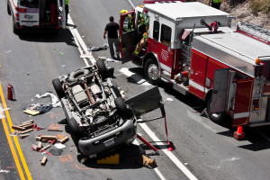 MONTEREY, CALIFORNIA - JUNE 29, 2013: The scene of a traffic accident involving an overturned sport utility vehicle.