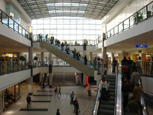 shoppers in a big shopping center with elevators